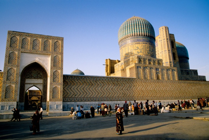 A street market outside the Registan. Photograph Alamy via The Guardian