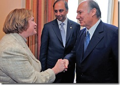 Glenview Village President Kerry Cummins shakes hands with the Aga Khan