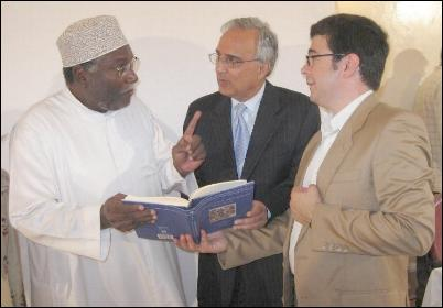 Dr Nader El-Bizri and Professor Azim Nanji explaining to Professor Rashid some of the refe- rences in the book