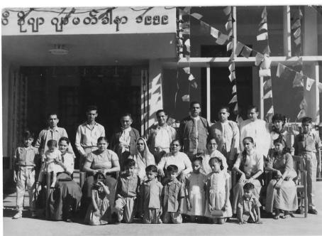 Photograph Nazir Alimohammad and family, far right, kneeling down, 1960 Burma