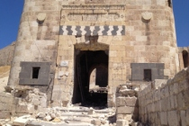 The badly damaged outer gate of Aleppo's Citadel.