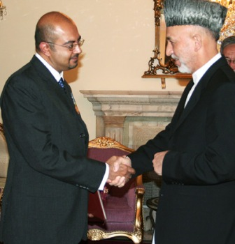 Canada's Ambassador to Afghanistan, Arif Lalani being greeted by Afghanistan's President Hamid Karzai