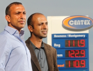 Brothers Alnnor, left, and Shafiq Bhura stand outside one of the their 43 Centex gas outlets