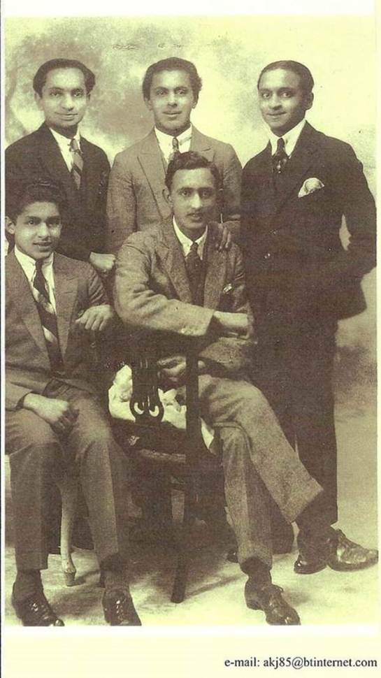 Studio photo shows some of the Verjee boys who were studying in the UK in the 1930s. Standing from left: Rumi's grandfather Rajabali Kassam Suleman Verjee, Hassanali Hussein Suleman Verjee and Gulamali Madatali Suleman Verjee. Seated John Hussein Suleman Verjee and my father Kassam Janmohamed Hasham Verjee.