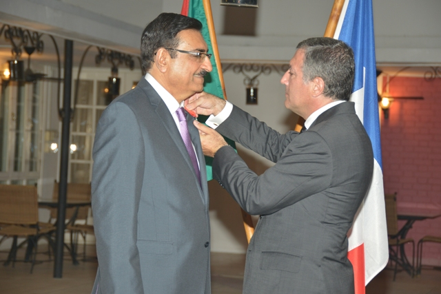 The Ambassador of France to Tanzania, His Excellency Marcel ESCURE, bestowed his country's highest decoration on Mr. Amin KURJI who is the Resident Representative of the Aga Khan Development Network in Tanzania on Tuesday the 24th of September 2013.