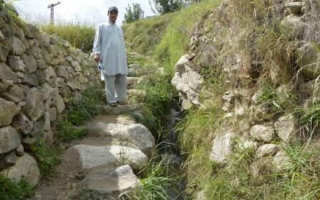 Flood-resilient streams protect mountain farms, villagers in north Pakistan - financially backed by Aga Khan Rural Support Programme