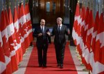 The Aga Khan, spiritual leader of the Ismaili Muslims, walks with Prime Minister Stephen Harper down the Hall of Honour on Parliament Hill in Ottawa on Thursday, Feb. 27, 2014, as they make their way to a signing ceremony. (AP Photo/The Canadian Press, Sean Kilpatrick)