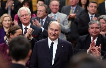 The Aga Khan, spiritual leader of the world's 15-million Shia Ismaili Muslims, receives a standing ovation from the House of Commons, on Parliament Hill in Ottawa, Thursday February 27, 2014. THE CANADIAN PRESS/Fred Chartrand