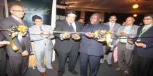 Prime Minister, Mizengo Pinda and President of his Highness Price Aga Khan Shia Imami Islaili Council for Tanzania, Jehangir Bhaloo (Centre) cut the ribbon to launch the Rays of Light Exhibition in Dar es Salaam yesterday. PHOTO|VENANCE NESTORY