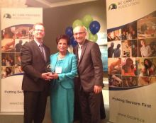 Nurjehan Devji presented award by B.C. Health Minister Terry Lake