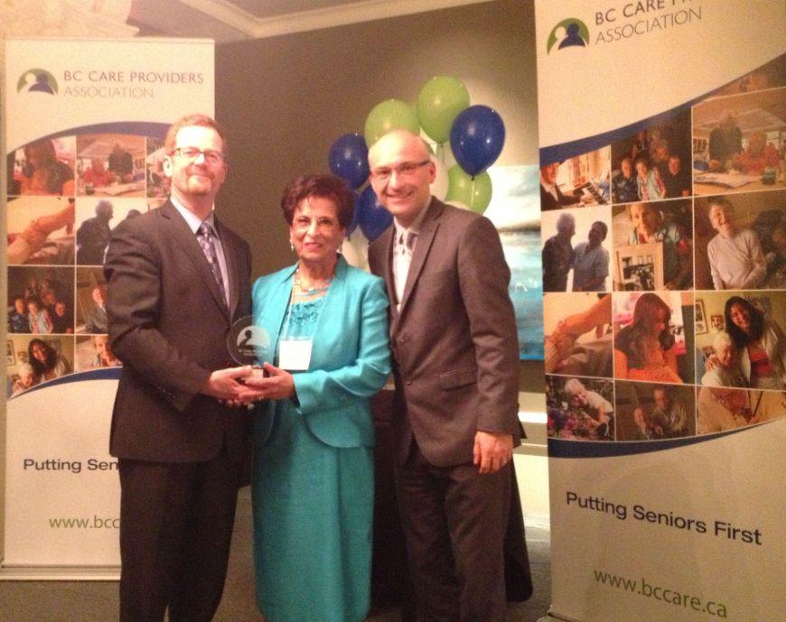 Nurjehan Devji presented award by B.C. Health Minister Terry Lake