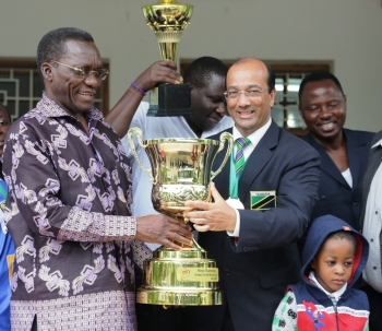Hon. Prime Minister of Tanzania and Altaf Hirani, holding the Street Child World Cup 2014 Trophy Hirani's soccer team won at the competetion held in Rio just before the FIFA World Cup.