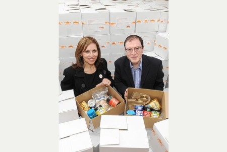 Community effort: Farida Bata and Zulfikar Hassam, both of Share A Smile, with some of their charity boxes