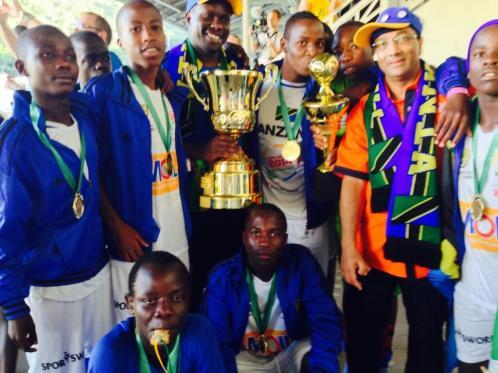 TSC President Altaf Hirani with the winning Team Tanzania enjoying the SCWC 2014 trophies.