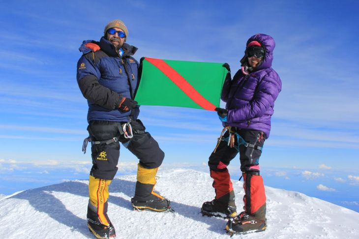 Mirza and Samina - the brother-sister duo proudly display the Ismaili My Flag on the summit of Mt. Mckinley.