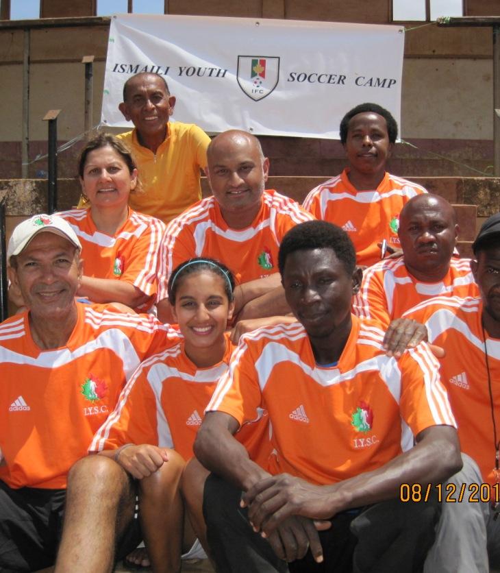 Seated from Top – left to right: Amyn Bhulji Shain Bhulji, Amin Kanji & John Mmbando (the Head of YES Tanzania – NGO – the Lead Co-ordinator) Alnoor (Bunju) Virani, Hannah Jiwani and Lawrance Manyonyi (Moshi Football Assoc.) Isack Gamba and Hamad Haule (the local coaches)
