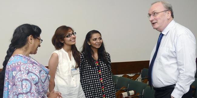 Dr Keith Cash, Dean SONAM and Salma Rattani, Director, BScN programme share a light moment with Anum Shiraz (second from right) and Sehrish Parwaiz (third from right)