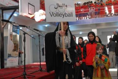Young Afghan female athletes march in an opening ceremony for their new gym