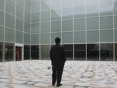CBC - Museum director Henry Kim takes a personal moment in the courtyard of the museum to admire the view. (Zulekha Nathoo:CBC)