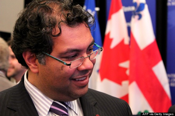 "Naheed Nenshi, the young charismatic mayor of Calgary, a city renowned conservative, listening carefully a participant of the conference on business opportunities in Calgary at the Hyatt Regency in Montreal on September 22, 2011. Being just an hour off Twitter is difficult for Calgary's savvy mayor, a Muslim who has gained authority despite his young age thanks to his charisma, humor and projects in the conservative city. ""In Canada and in particularly in Calgary, it's possible to do and to be anything regardless of where you come from,"" said Naheed Nenshi, smiling broadly beneath his small-framed glasses and brown curly hair, during a visit to Montreal to attract investor to his city.  (Photo credit: Marie Laure JOSSELIN/AFP/Getty Images)"