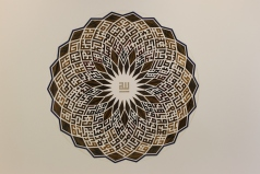 99 Names of Allah - Artwork by Minaz Nanji using tigers eye, lapis lazuli and other gemstones.