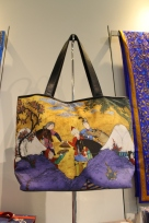Ladies bag with a partial image of an AKM Masterpiece that also adorns the wall of the Gift Shop.