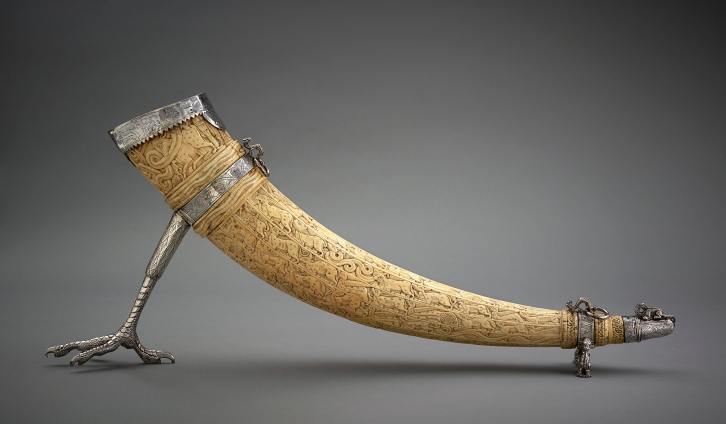 Ivory Horn (Oliphant) Southern Italy, 11th–12th centuries (mount: Great Britain, early 17th century) Carved ivory with silver mount Length 64 cm, height 34 cm AKM809