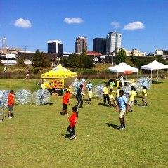 Kids enjoying bubble soccer
