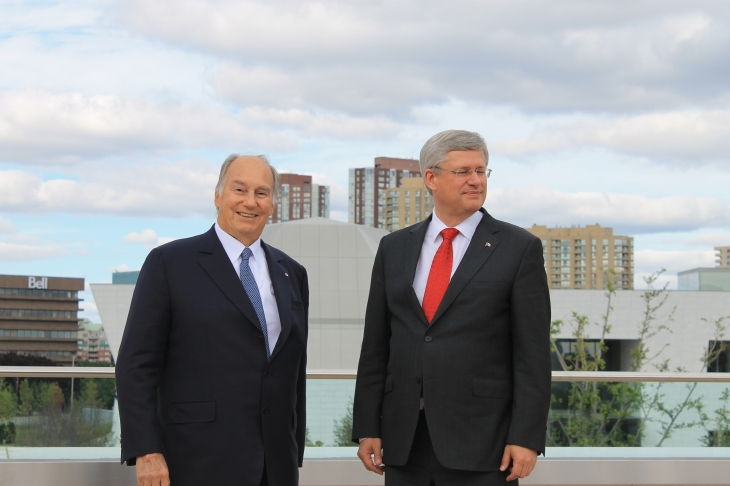 Mowlana Hazar Imam and Canadian Prime Minister Stephen Harper at the roof-top terrace of the Ismaili Centre, Toronto with the Aga Khan Museum in the background. [Image © Ismailimail/AM]