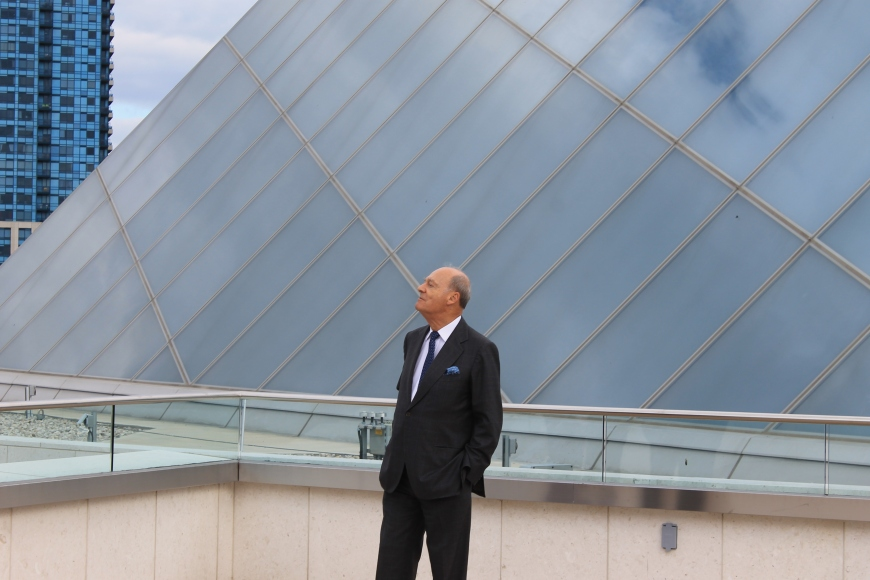 Prince Amyn looking at the Aga Khan Museum from the terrace of the Ismaili Centre, Toronto (crystalline rooftop in the background)