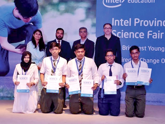 Aga Khan Higher Secondary School Student Excel. One of the groups at the science fair holding their certificates. PHOTO: COURTESY INTEL