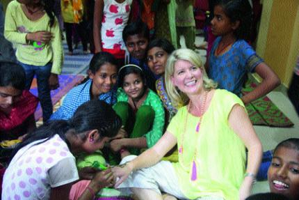 Australia's ambassador for women and girls Natasha Stott Despoja gets henna put on her hand from a group of young girls. (Image: The Asian Age)