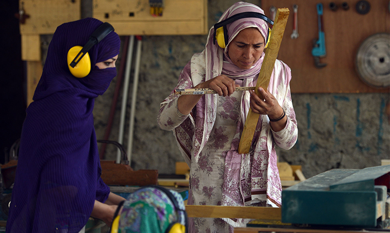 High in Pakistan's mountains, women break taboos: Carpenters work at their woodshop in Altit village in northern Hunza valley. AFP Photo