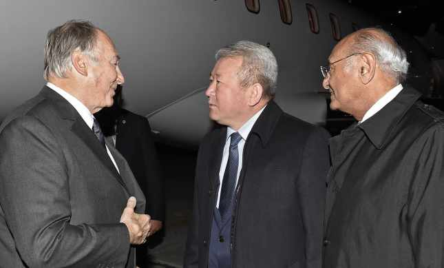 Mawlana Hazar Imam is received by Minister Kanat Sadykov and AKDN Representative Shamsh Kassim-Lakha upon his arrival in Bishkek. (The Ismaili - AKDN / GARY OTTE)