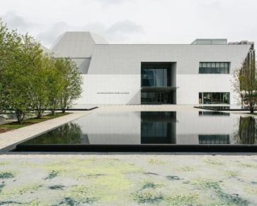 Exterior of the Aga Khan Museum - paving of the garden's grounds adorned with a floral pattern by Pakistani artist Imran Qureshi. (Photo via Monocle)