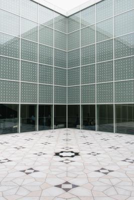 Interior courtyard where the windows and floor are adorned with geometric 'mashrabiya' patterns. (Photo via Monocle)