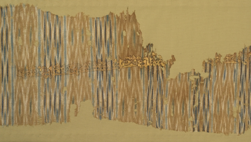 Ikat shawl with painted inscription Cotton tabby with warp ikat pattern, ink, gold leaf Yemen 10th century 970.364.19 (ROM)