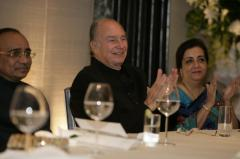 India, 2013 -Mawlana Hazar Imam, joined by Ismaili Council President Aitmadi Gulam Rahimtoola and President Banoo Samira Rahimtoola, applauds the musical performance at the Jamati institutional banquet (Photo: The Ismaili/Nazim Lokhandwala)