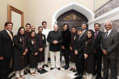 India, 2013 - Mawlana Hazar Imam poses for a photograph with the performers at the conclusion of the institutional dinner Imam (Photo: The Ismaili/Aziz Ajaney)