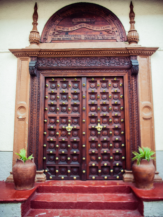 Entrance door to the Zanzibar Jamatkhana. <br /> The carved wooden doors were specially made for the Jamatkhana and shipped from India. <br />The Zanzibar Jamatkhana and the beautifully carved doors are over 100 years old.