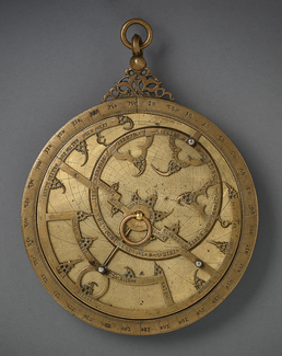 This astrolabe may have been made in Toledo, Spain, then a major centre of scientific translation. The inscriptions on the astrolabe bear the names of constellations in both Arabic and Latin, with additional inscriptions in Arabic. Later, Hebrew was added to one of the plates. Muslim scientists worked together with Christian and Jewish counterparts to translate and transmit scientific knowledge to Europe. (image Aga Khan Museum)