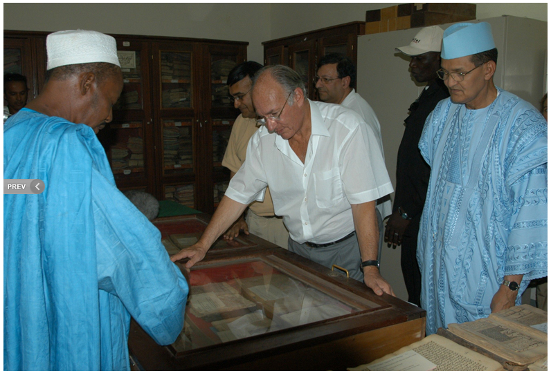 From Ismailimail Archives: Timbuktu, Mali, 10 October 2003. His Highness the Aga Khan (centre) and Prime Minister Ahmed Mohamed Ag Hamani (right) examining ancient manuscripts at the Ahmed Baba Centre in Timbuktu, Mali. - Photo AKDNGary Otte