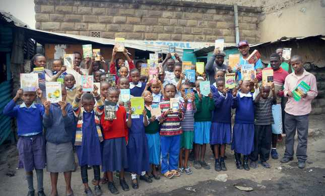 Children at Viara Junior Academy receive books as rewards for their commitment to learning. (Courtesy of Bamba)