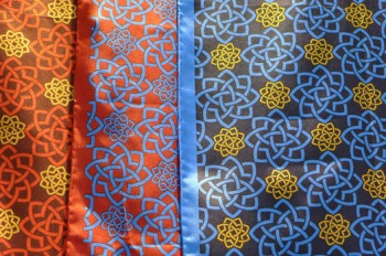 Beautiful scarves and ties in the museum shop feature the Aga Khan Museum logo symbol. (Image: Examiner/Lesley Peterson)
