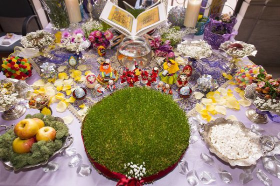 To celebrate the new year, families gather around a specially prepared holiday table to make wishes for the coming months. Items on the haft sin table refer to new life and renewal. Haft sin table at the Freer|Sackler's 2013 Nowruz celebration. Photo by Freer|Sackler staff photographer.