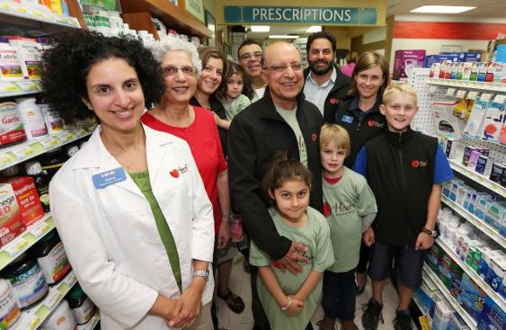 Running the newly renamed Heart pharmacies is a family business for the Rayanis, including, from left, Zahra Rayani-Kanji, Yasmine Rayani, Laurel Rayani, Naeema Rayani, 4, Farhan Kanji, founder Naz Rayani, Anigg Rayani, 7, Rasool Rayani, Rhys Watson, 8, Adele Fraser and Miles Watson, 10.   (Photograph By ADRIAN LAM, Times Colonist)