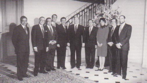 February 25, 1992: His Highness the Aga Khan, 49th Shia Ismaili Imam, pictured with members of the US Aga Khan Foundation National Committee (1989-1992) at his residence on the occasion of the Aga Khan Foundation's 25th anniversary. From left to right: Tajdin Mitha, Shahbudin Rahimtoola, Habibullah Jamal (President, US Aga Khan Council), Iqbal Paroo, Zulfikar Esmail (Chairman, AKF, USA), the Aga Khan, Azim Nanji (Vice Chairman), Fariyal Ross-Sheriff, Lutaf Dhanidina and Iqbal Noor Ali (then CEO, AKF USA). Photo: The Ismaili, USA.