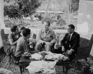 Sultan talking to Prince Amyn at the family coffee plantation near Arusha. SUltan's mom Fatma and dad Kamrudin are with them.