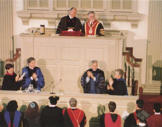 From Ismailimail Archives - May 26, 1996: His Highness the Aga Khan receives a standing ovation at the conclusion of the Baccalaureate Address at Brown University, Providence, Rhode Island. The President, Vartan Gregorian, is next to him. (Image credit Simerg,com)