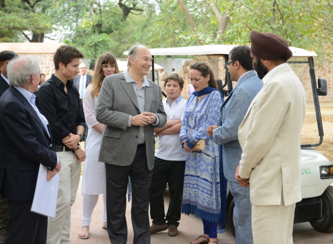 Mawlana Hazar Imam speaking with AKTC staff after touring the Sundar Nursery and Batashewala complex with Prince Aly Muhammad, Princess Zahra and her children, Sara and Iliyan. (Image credit: AKDN / Narendra Swain via TheIsmaili.org)